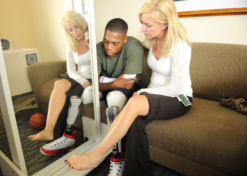 An occupational therapist is caring for a patient with an artificial limb